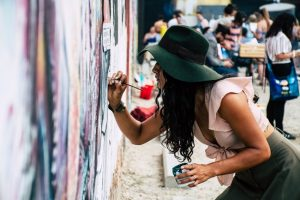 photo-of-woman-painting-on-wall